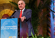 President McRobbie speaking from the International Center award podium