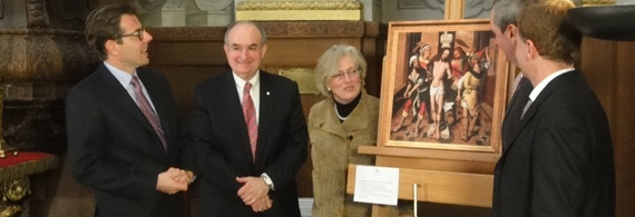 President McRobbie and others gather around a painting