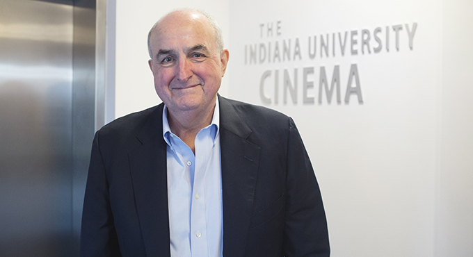 IU President Michael A. McRobbie in front of IU Cinema sign