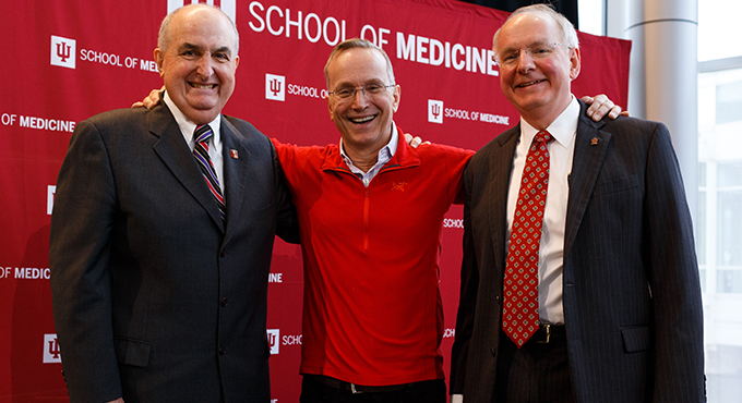 IU President Michael A. McRobbie stands with Don Brown and IU School of Medicine Dean Jay Hess