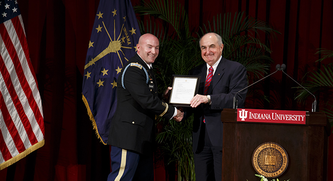 President McRobbie presenting the General Douglas MacArthur Award to an IU ROTC cadet